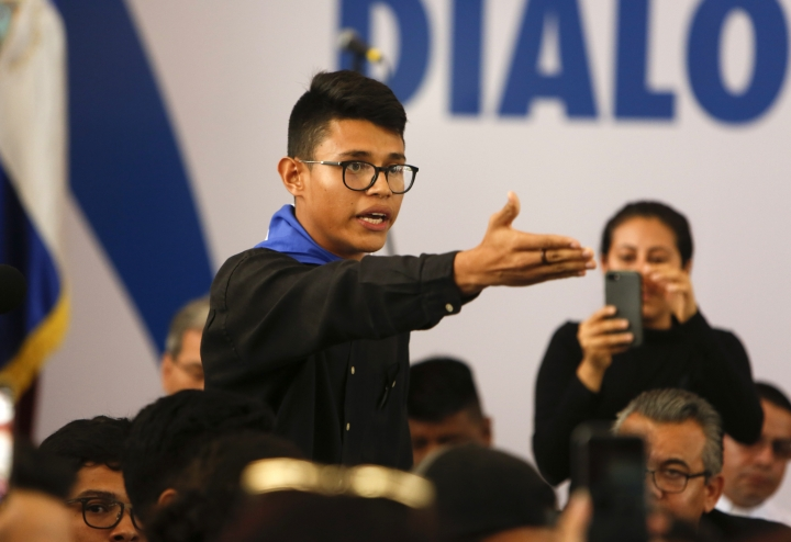"""Student representative Lesther Aleman interrupts Nicaragua's President Daniel Ortega, shouting that he must halt the repression, during the opening of the national dialogue, on the outskirts of Managua, Nicaragua. """"Order it now, in this moment, the repression of the police, of the paramilitary forces, of your party's gangs that have been massacring and killing.... In less than a month you've ruined the country; Somoza took years."""" Aleman said, alluding to dictator Anastasio Somoza whose government was toppled by the Sandinista rebels in 1979. (AP Photo/Alfredo Zuniga)"""
