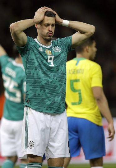 File -- In this Tuesday, March 27, 2018 photo Germany's Sandro Wagner reacts during the international friendly soccer match between Germany and Brazil in Berlin, Germany. Brazil defeated Germany by 1-0. (AP Photo/Michael Sohn, file)