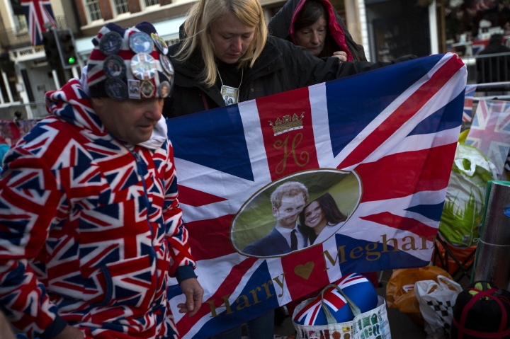 People who spent the night outside Windsor Castle in Windsor, England, organise their belongings after waking up, early Thursday, May 17, 2018. Preparations continue in Windsor ahead of the royal wedding of Britain's Prince Harry and Meghan Markle on Saturday May 19. (AP Photo/Emilio Morenatti)