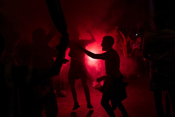 Atletico Madrid supporters light flares as they celebrate their team's Europa League title in Madrid, early Thursday, May 17, 2018. Atletico defeated Marseille 3-0 in the final and clinches its third Europa League title. (AP Photo/Francisco Seco)