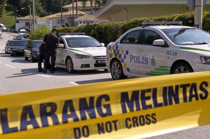 An entrance road to the resident of former Malaysian Prime Minister Najib Razak is cordoned off in Kuala Lumpur, Malaysia, Thursday, May 17, 2018. Malaysian police spent hours early Thursday searching former Prime Minister Najib Razak's house, reportedly part of a money-laundering investigation linked to a state investment fund that is being investigated abroad. (AP Photo/Sadiq Asyraf)