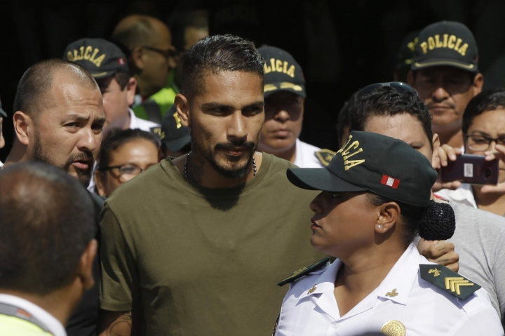 """Peru captain Paolo Guerrero arrives in Lima, Peru, Tuesday, May 15, 2018. The global footballers' union wants FIFA's help to review anti-doping rules after Guerrero was banned from the World Cup for a positive test for cocaine caused by contaminated tea. FIFPro says a 14-month ban barring the 34-year-old Guerrero from his World Cup debut is """"unfair and disproportionate."""" (AP Photo/Martin Mejia)"""