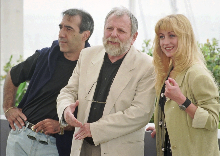 "FILE- In this May 15, 1996 file photo, Romanian director Lucian Pintilie, center, poses with actors Razvan Vasilescu, left, and Cecilia Barbora before the presentation of his movie ""Too Late"" at the 49th International Cannes Film Festival. Romanian director and filmmaker Lucian Pintilie who emigrated after falling out with the communists and then made a career in France and the U.S. has died, aged 84. (AP Photo/Remy de la Mauviniere, File)"