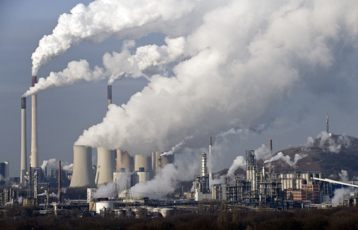 FILE - In this Dec. 16, 2009 file photo, steam and smoke rise from a coal burning power plant in Gelsenkirchen, Germany. The European Union is taking six member states to court for exposing their citizens to too much air pollution. The European Commission on Thursday, May 17, 2018 referred France, Germany, Hungary, Italy, Romania and Britain the EU's highest Court of Justice saying they failed to respect air quality limits and did not take appropriate action in time. (AP Photo/Martin Meissner, File)
