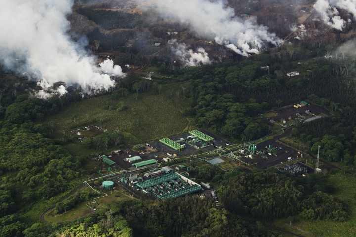 An aerial view of Hawaii's Kilauea East Rift zone and the Puna Geothermal Venture plant is seen, Wednesday, May 16, 2018. Earthquakes were damaging roads and buildings on Hawaii's Big Island on Wednesday as ash emissions streamed from Kilauea volcano. (Cindy Ellen Russell/Honolulu Star-Advertiser via AP)