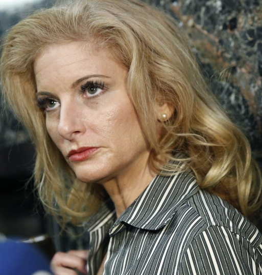 "FILE - In this Dec. 5, 2017 file photo, Summer Zervos is seen after a hearing at Manhattan Supreme Court judge in New York. A New York court said Thursday, May 17, 2018, that the former ""Apprentice"" contestant can proceed with her defamation lawsuit against President Donald Trump, at least for now. (AP Photo/Kathy Willens, File)"