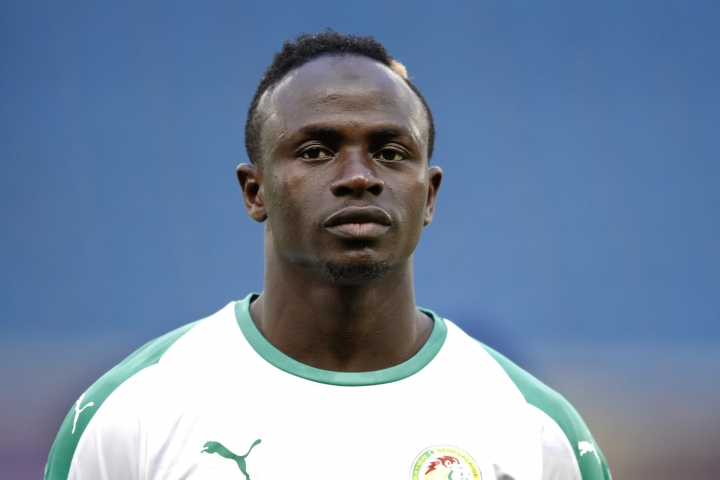 FILE - In this Tuesday, March 27, 2018 file photo, Senegal's Sadio Mane listens to national anthem prior to their friendly soccer match against Bosnia and Herzegovina at the Oceane stadium in Le Havre, northern France. Senegal has named its final 23-man squad for the World Cup, with Liverpool forward Sadio Mane leading a group that also includes key defender Kalidou Koulibaly of Napoli and midfielder Cheikh Kouyate of West Ham. (AP Photo/Francois Mori, file)