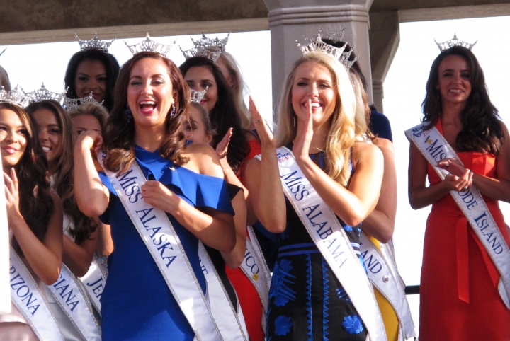 In this Aug. 30, 2017 photo, contestants attend a welcoming ceremony for the Miss America competition on the Atlantic City, N.J. Boardwalk. On Thursday, May 17, 2018, the Miss America Organization announced it has installed women in the organization's three top leadership posts following an email scandal last winter involving male leaders. (AP Photo/Wayne Parry)