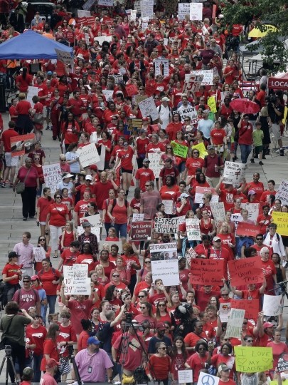 Participants make their way towards the Legislative Building during a teachers rally at the General Assembly in Raleigh, N.C., Wednesday, May 16, 2018. Thousands of teachers rallied at the state capital seeking a political showdown over wages and funding for public school classrooms. (AP Photo/Gerry Broome)
