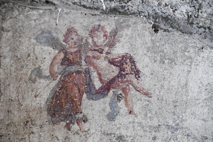 A detail of a fresco that was found during excavation works in the archaeological site of Pompeii, Thursday, May 17, 2018. Archaeologists excavating an unexplored part of Pompeii have discovered a street of houses with intact balconies that were buried when Mt. Vesuvius erupted in 79 AD. (Ciro Fusco /ANSA via AP)