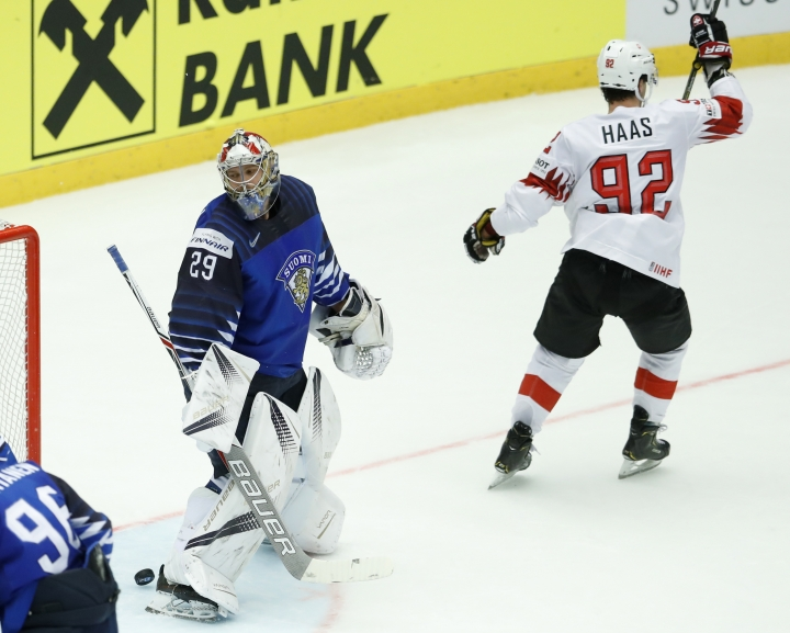 Switzerland's Gaetan Haas, right, celebrates after Finland's goalkeeper Harri Sateri, left, failed to make a save during the Ice Hockey World Championships quarterfinal match between Finland and Switzerland at the Jyske Bank Boxen arena in Herning, Denmark, Thursday, May 17, 2018. (AP Photo/Petr David Josek)