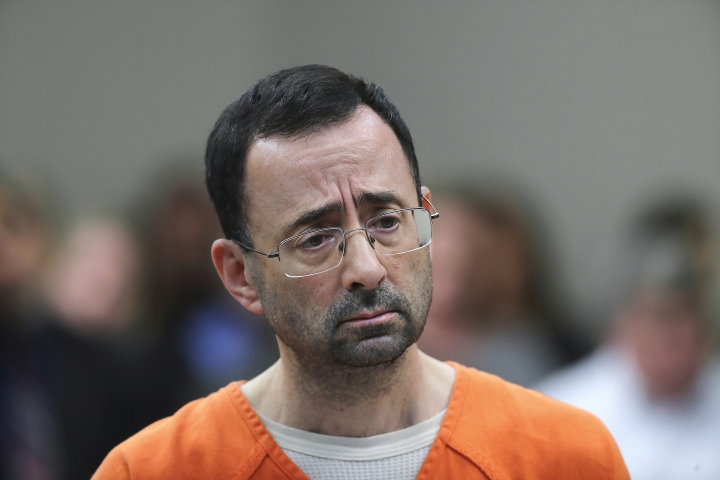 FILE - In this Nov. 22, 2017, file photo, Dr. Larry Nassar appears in court for a plea hearing in Lansing, Mich. Michigan State University has reached a $500 million settlement with hundreds of women and girls who say they were sexually assaulted by Nassar in the worst sex-abuse case in sports history. The deal was announced Wednesday, May 16, 2018, by Michigan State and lawyers for 332 victims. (AP Photo/Paul Sancya, File)