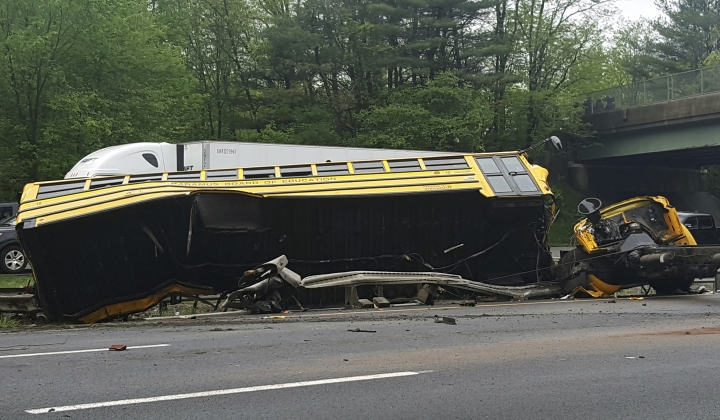 This photo shows an overturned school bus after it collided with a dump truck, injuring multiple people, on Interstate 80 in Mount Olive, N.J., Thursday, May 17, 2018. (Chrissy Oleszek via AP)