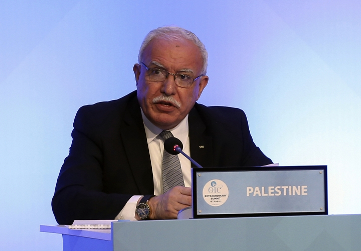 Palestinian Foreign Minister Riyad al-Maliki makes a speech as he attends the Extraordinary summit of the Organization of Islamic Cooperation (OIC) in Istanbul, Turkey, Friday, May 18, 2018. Turkey has called on Muslim nations to stand with Palestinians and to work to stop countries joining the United States in relocating their Israeli embassy from Tel Aviv to Jerusalem.(Anadolu Agency/Pool via AP)