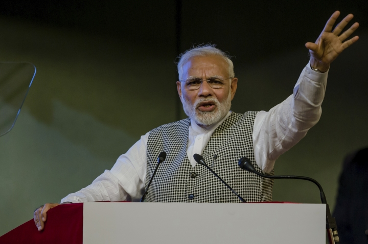 Indian Prime Minister Narendra Modi speaks during a function to inaugurate the Kishanganga hydropower station in Srinagar, Indian controlled Kashmir, Saturday, May 19, 2018. Modi inaugurated remotely a controversial hydroelectric power project built in the Gurez Valley, just a few hundred meters (yards) from the highly militarized Line of Control that divides Kashmir between India and Pakistan. (AP Photo/Dar Yasin)