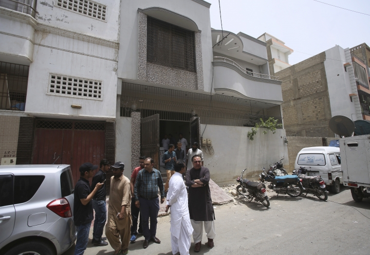 People gather outside the native home of Sabika Sheikh, a victim of a shooting at a Texas high school, for condolence in Karachi, Pakistan, Saturday, May 19, 2018. The Pakistani foreign exchange student is among those killed in the shooting, according to a leader at a program for foreign exchange students and the Pakistani Embassy in Washington, D.C. Megan Lysaght, manager of the Kennedy-Lugar Youth Exchange & Study Abroad program (YES), sent a letter to students in the program confirming that Sabika Sheikh was killed in the shooting. (AP Photo/Fareed Khan)