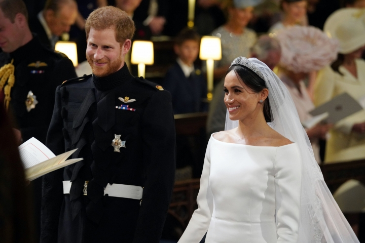 Britain's Prince Harry and Meghan Markle, during their wedding ceremony at St. George's Chapel in Windsor Castle in Windsor, near London, England, Saturday, May 19, 2018. (Gareth Fuller/pool photo via AP)