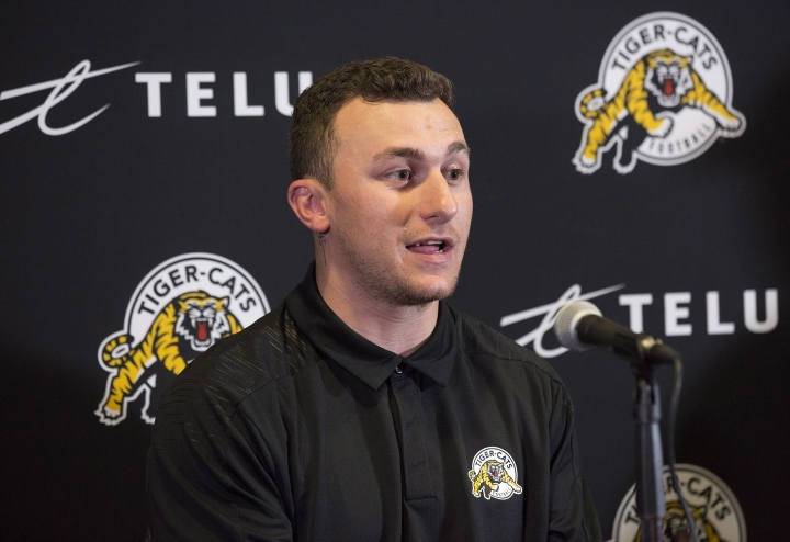 Former NFL quarterback and Heisman Trophy winner Johnny Manziel, speaks at CFL press conference, Saturday, May 19, 2018, in Hamilton, Ontario, after announcing that he has signed a two-year contract to play for the Hamilton Tiger-Cats. (Aaron Lynett/The Canadian Press via AP)