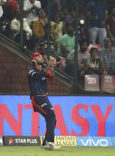 Delhi Daredevils Glenn Maxwell takes the catch of Mumbai Indians Ben Cutting during the VIVO IPL Twenty20 cricket match in New Delhi, India, Sunday, May 20, 2018. (AP Photo/Manish Swarup)