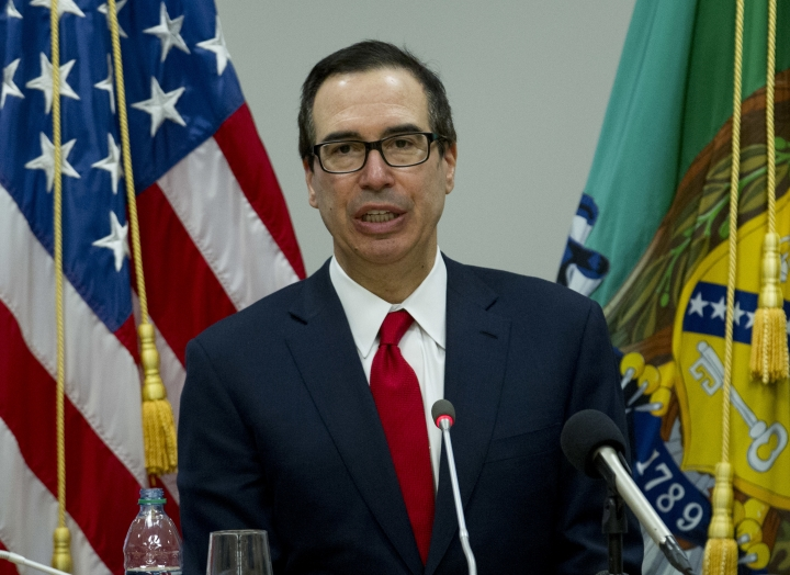 FILE - In this Saturday, April 21, 2018, file photo, Treasury Secretary Steve Mnuchin speaks during a news conference at World Bank/IMF Spring Meetings, in Washington. China's government says it cannot guarantee renewed trade tension with Washington can be avoided after U.S. Treasury Secretary Steven Mnuchin declared a temporary truce in a dispute companies worried might chill global commerce. (AP Photo/Jose Luis Magana, File)