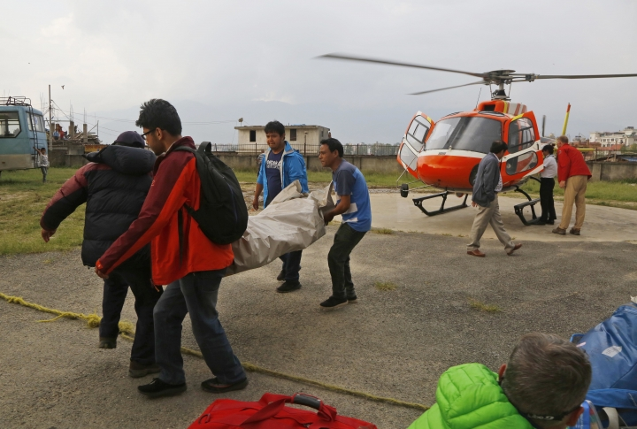 The body of a Macedonian 63-year-old Gjeorgi Petkov is unloaded from a helicopter at Teaching Hospital in Kathmandu, Nepal, Monday, May 21, 2018. Two foreign climbers, including Petkov, attempting to scale Mount Everest have died on the world's highest peak, a Nepal mountaineering official said Monday. (AP Photo/Niranjan Shrestha)