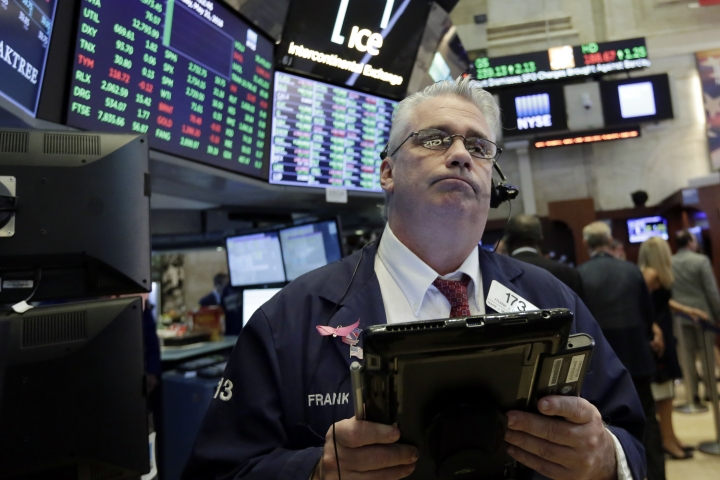 Trader Frank O'Connell works on the floor of the New York Stock Exchange, Monday, May 21, 2018. Stocks are opening solidly higher on Wall Street after trade tensions between the U.S. and China dissipated. (AP Photo/Richard Drew)