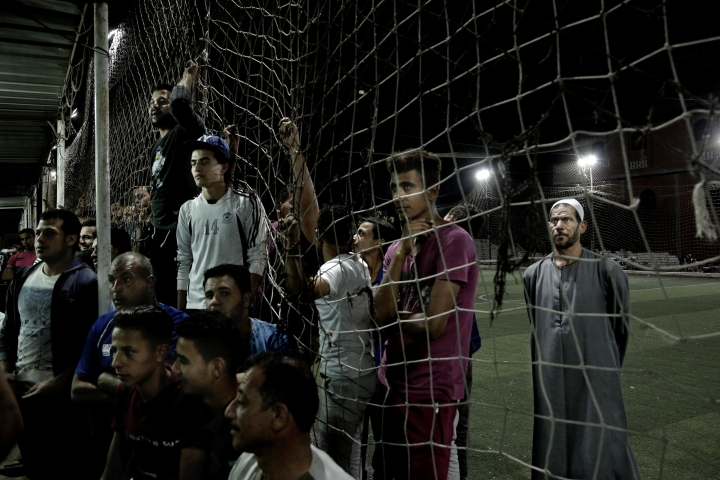 In this May 2, 2018 photo, men watch the Liverpool vs. Roma match in Mohamed Salah's hometown Nile delta village of Nagrig, Egypt. Residents boast of how the Liverpool winger has poured millions of pounds into the village, with the beneficiaries' list including a school, a mosque, a youth center and a dialysis machine at a nearby hospital. His success as a footballer in Europe's most attractive league has inspired many parents in Nagrig to send their children to soccer academies in the hope that maybe one day they can emulate his success. (AP Photo/Nariman El-Mofty)