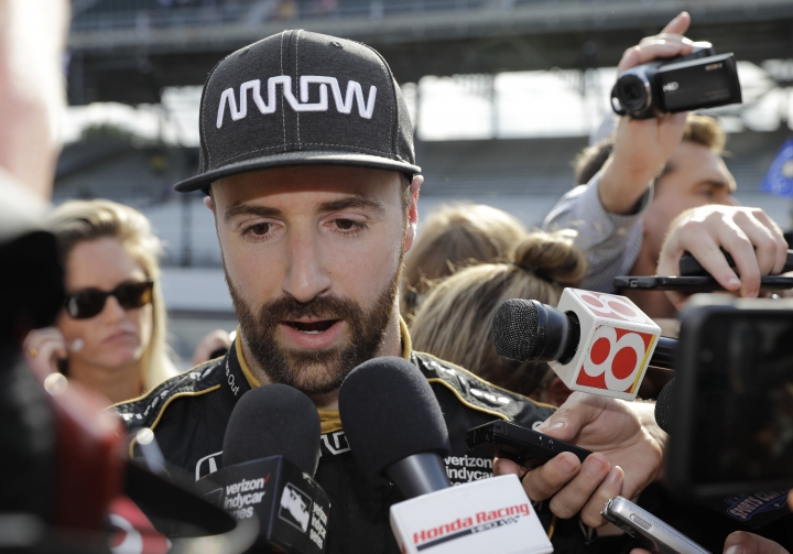 FILE- In this May 19, 2018 file photo, James Hinchcliffe, of Canada, talks with the media after he did not qualify for the IndyCar Indianapolis 500 auto race at Indianapolis Motor Speedway in Indianapolis. James Hinchcliffe once likened Indianapolis Motor Speedway to a cruel mistress. He found out just how cruel when he was bumped from the race that means the most to him and to any IndyCar driver. But he will be at the track Sunday trying to help his teammates win the Indy 500. (AP Photo/Darron Cummings, File)
