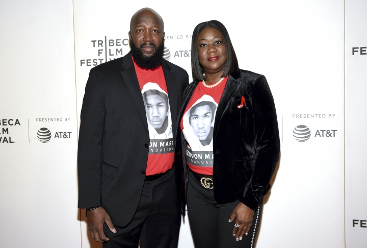 """FILE - In this Friday, April 20, 2018, file photo, Trayvon Martin's parents, Tracy Martin, left, and Sybrina Fulton, attend the Tribeca TV screening of """"Rest in Power: The Trayvon Martin Story"""" at BMCC Tribeca PAC, during the 2018 Tribeca Film Festival in New York. Martin and Fulton say The Weinstein Company owes them at least $150,000 for optioning the rights to their book in order to make a yet unaired television series based on their son's legacy. (Photo by Evan Agostini/Invision/AP, File)"""