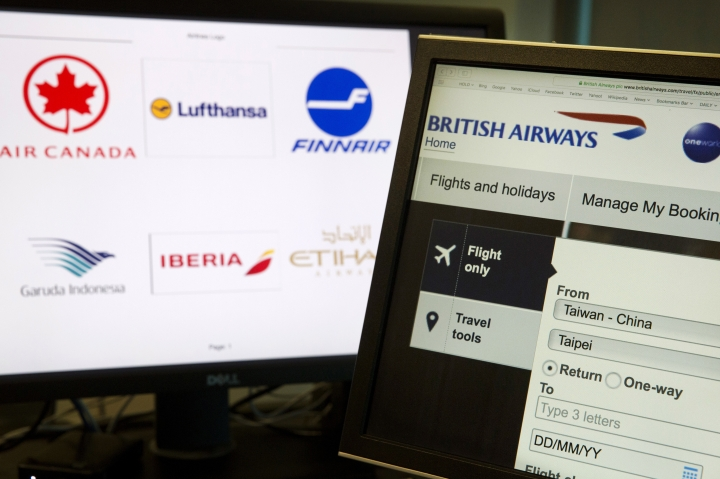 """In this May 21, 2018, photo, a computer screens display the booking website of British Airways showing """"Taiwan-China"""" in Beijing, China. Global airlines are obeying Beijing's demands to refer to Taiwan explicitly as a part of China, despite the White House's call this month to stand firm against such """"Orwellian nonsense."""" (AP Photo/Ng Han Guan)"""