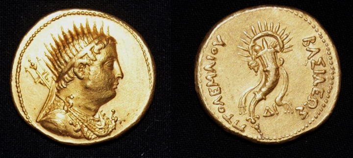 This undated photo released by the Egyptian Ministry of Antiquities, shows a gold coin, depicting King Ptolemy III, who ruled Egypt in the 3rd century B.C. and was an ancestor of the famed Cleopatra, that was found in the San El-Hagar archaeological site in Gharbia province, north of Cairo, Egypt. Egyptian archeologists said they discovered parts of a huge red brick building dating back to the Greco-Roman period and have unearthed other artifacts in the area, including pottery vessels, terracotta statues, bronze tools and a small statue of a ram. (Egyptian Ministry of Antiquities via AP)