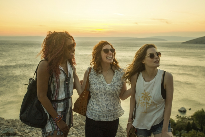 "This image released by Netflix shows, from left, Phoebe Robinson, Vanessa Bayer and Gillian Jacobs in a scene from ""Ibiza."" (Aleksandar Letic/Netflix via AP)"