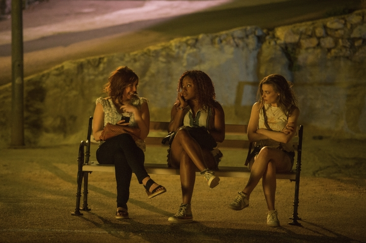"This image released by Netflix shows, from left, Vanessa Bayer, Phoebe Robinson and Gillian Jacobs in a scene from ""Ibiza."" (Aleksandar Letic/Netflix via AP)"