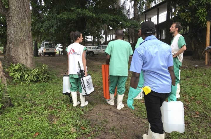 In this photo taken Sunday, May 20, 2018, a team from Medecins Sans Frontieres (Doctors Without Borders) carries protective equipment as they prepare to treat Ebola patients in an isolation ward of Mbandaka hospital in Congo. Congo's health ministry announced Tuesday, May 22, 2018 six new confirmed cases of the Ebola virus and two new suspected cases while a vaccination effort enters its second day. (Louise Annaud/Medecins Sans Frontieres via AP)