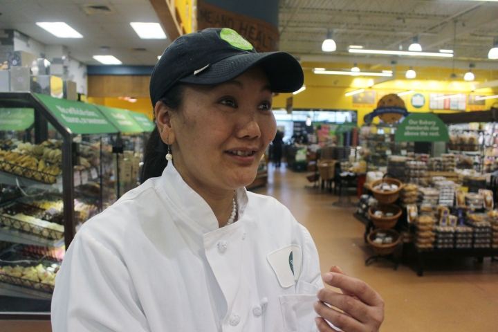 In this April 3, 2018 file photo, mountain climber Lhakpa Sherpa prepares to start her shift as a dishwasher at the Whole Foods Market in West Hartford, Conn. Lhakpa Sherpa scaled Mount Everest for the ninth time, shattering her own record for the most climbs by a woman. (AP Photo/Pat Eaton-Robb, File)