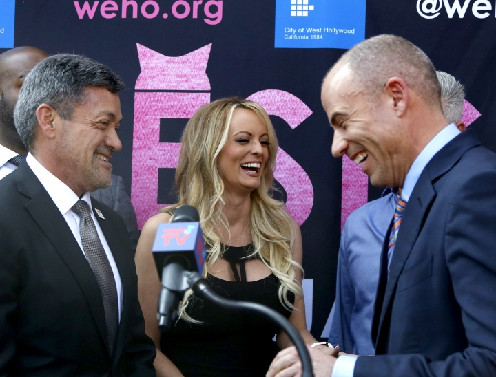 West Hollywood Mayor John Duran, left, Stormy Daniels, center, and attorney Michael Avenatti attend a ceremony for Daniels receiving a City Proclamation and Key to the City on Wednesday, May 23, 2018 in West Hollywood, Calif. (AP Photo/Ringo H.W. Chiu)