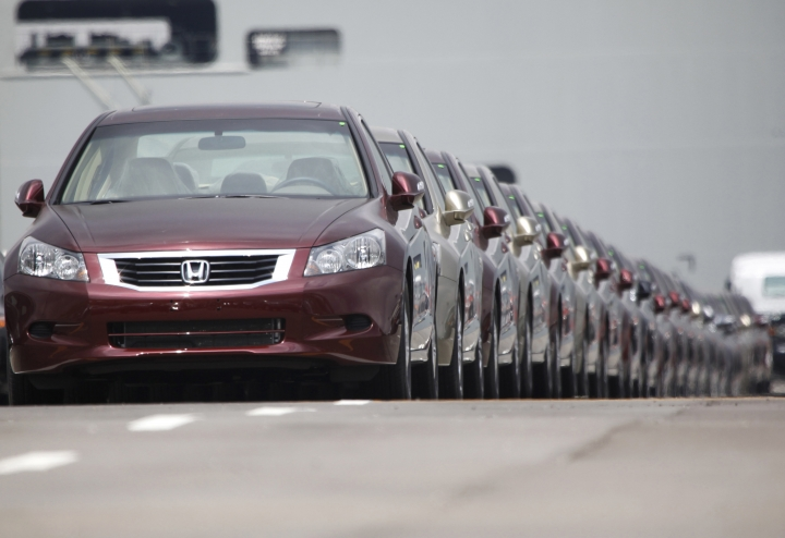 FILE - In this March 29, 2010 file photo, Japanese automaker Honda Motor Co.'s vehicles for export park at a Yokohama port, near Tokyo, Japan. China and Japan both condemned Thursday, May 24, 2018 the Trump administration's decision to launch an investigation into whether tariffs are needed on imports of vehicles and automotive parts into the United States. (AP Photo/Shizuo Kambayashi, File)
