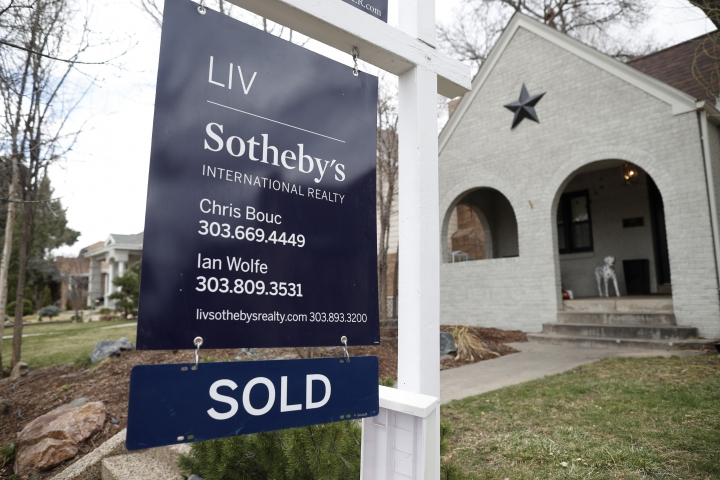 FILE- In this March 28, 2018, photo a sold sign is shown outside a single-family home on the market in Denver. On Thursday, May 24, the National Association of Realtors reports on April sales of existing homes. (AP Photo/David Zalubowski, File)