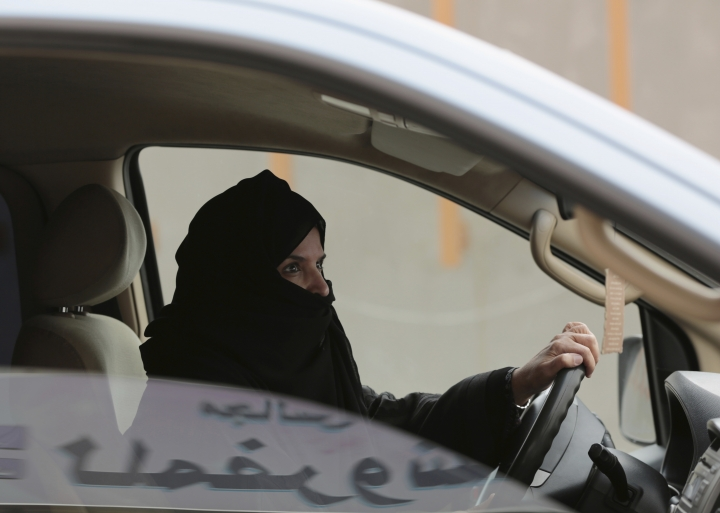 FILE - In this March 29, 2014 file photo, Aziza al-Yousef drives a car on a highway in Riyadh, Saudi Arabia, as part of a campaign to defy Saudi Arabia's ban on women driving. Saudi Arabia's arrest of 10 women's rights advocates just weeks before the kingdom is set to lift the world's only ban on women driving is seen as the culmination of a steady crackdown on anyone perceived as a potential critic of the government. (AP Photo/Hasan Jamali, File)