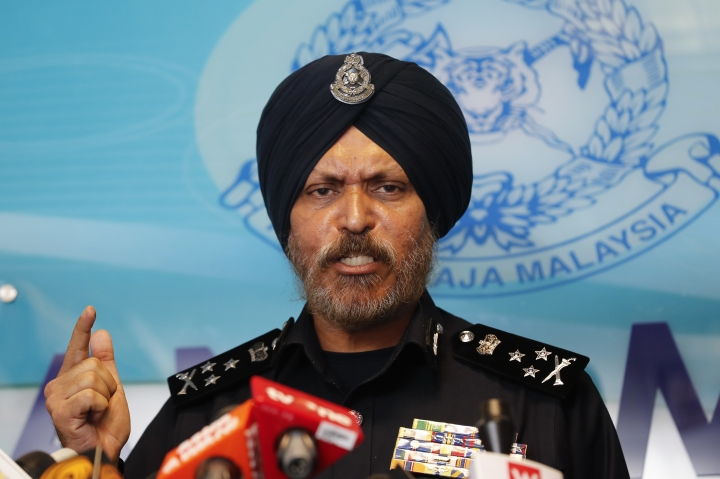 Federal Commercial Crime Investigation Department (CCID) director Amar Singh speaks during a press conference in Kuala Lumpur, Malaysia, Friday, May 25, 2018. Police have revealed that the total amount of cash seized from the Pavilion Residences as part of its investigations into 1MDB also total of 72 bags were seized, and from that 72 bags, 35 bags contained cash. (AP Photo/Vincent Thian)