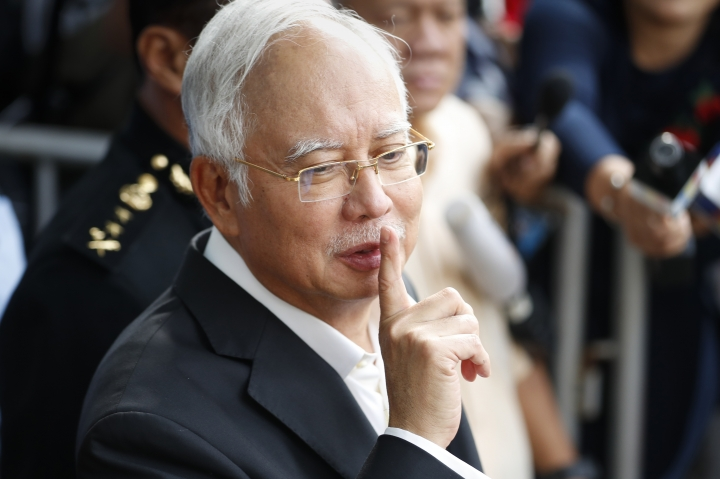 Former Malaysian Prime Minister Najib Razak gestures as he leaves the Malaysian Anti-Corruption Commission (MACC) Office in Putrajaya, Malaysia, Thursday, May 24, 2018. Najib appeared again for questioning at the office as part of the corruption and money-laundering investigation into the 1MDB state investment fund that Najib set up and is being investigated. (AP Photo/Vincent Thian)