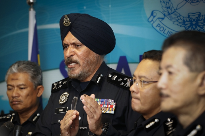 Federal Commercial Crime Investigation Department (CCID) director Amar Singh speaks during a press conference in Kuala Lumpur, Malaysia, Friday, May 25, 2018. Police have revealed that the total amount of cash seized from Pavilion Residences as part of its investigations into 1MDB also total of 72 bags were seized, and from that 72 bags, 35 of the bags contained cash. (AP Photo/Vincent Thian)