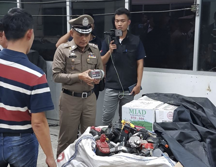 In this photo taken Thursday, May 24, 2018, and released by the Royal Thai Police, a factory processing electronic waste is visited by police in Lat Krabang, outside Bangkok, Thailand. Police have raided several factories near Bangkok that allegedly were processing illegally imported electronic waste in a sign that China's crackdown on waste recycling is pushing such operations offshore. (Royal Thai Police via AP)