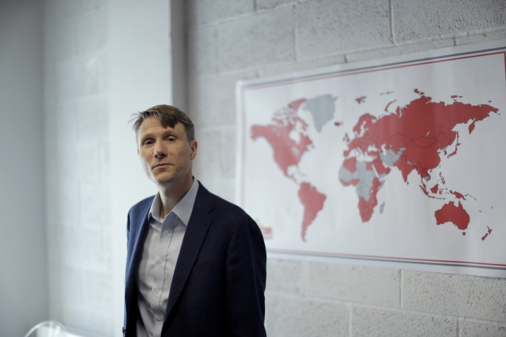 """The founder and CEO of """"My Nametags"""" Lars Andersen, originally from Norway, poses for photographs by a map showing in red their global sales coverage, at his business premises in London, Wednesday, May 23, 2018. Starting Friday, May 25, 2018, My Nametags and most other companies that collect or process the personal information of EU residents must comply with the new General Data Protection Regulation, which the EU calls the most sweeping change in data protection rules in a generation. (AP Photo/Matt Dunham)"""