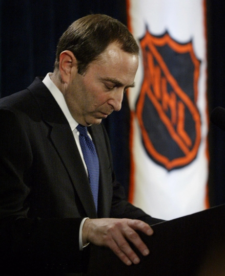 FILE - In this Feb. 16, 2005, file photo, NHL commissioner Gary Bettman listens to a question after announcing the cancellation of the current hockey season during a news conference in New York. Through work stoppages, the advent of the salary cap, expansion, in and then out of the Olympics, growing concern over head injuries among his players_ for they are all his players _ Bettman has guided the National Hockey League from a $437 million business into one nearing $5 billion. (Paul Chiasson/Canadian Press via AP, File))