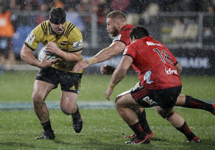 Hurricanes Ben May runs at the Crusaders defence during their Super Rugby match in Christchurch, New Zealand, Friday, May 25, 2018. (AP Photo/Mark Baker)