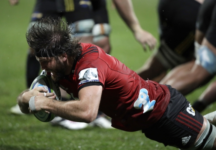 Crusaders Heiden Bedwell-Curtis dives across the line to score a try against the Hurricanes during their Super Rugby match in Christchurch, New Zealand, Friday, May 25, 2018. (AP Photo/Mark Baker)