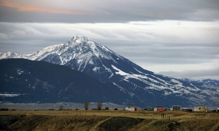 FILE - This Nov. 21, 2016 file photo shows Emigrant Peak towering over the Paradise Valley in Montana north of Yellowstone National Park. A gold exploration proposal in the area has suffered a significant setback after a judge ruled Montana officials understated mining's potential harm to land, water and wildlife. (AP Photo/Matthew Brown, File)