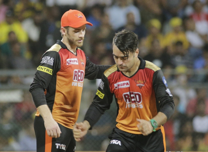 Sunrisers Hyderabads Kane Williamson, left, chats with Rashid Khan during during VIVO IPL cricket T20 final match against Chennai Super Kings in Mumbai, India, Sunday, May 27, 2018. (AP Photo/Rafiq Maqbool)