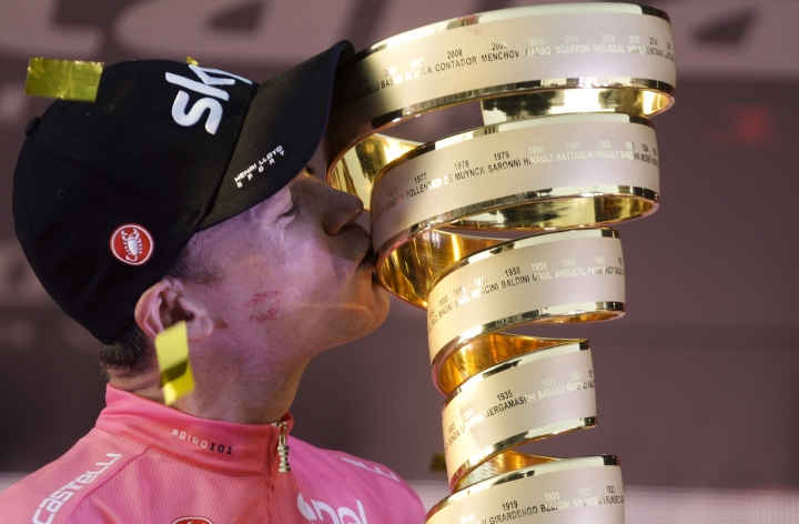 Britain's Chris Froome kisses the trophy of the Giro d'Italia cycling race, in Rome, Sunday, May 27, 2018. Chris Froome has won the Giro d'Italia for his third consecutive Grand Tour victory. The four-time Tour de France champion had no trouble protecting his 46-second lead over defending champion Tom Dumoulin in Sunday's mostly ceremonial final stage through historic Rome. (AP Photo/Gregorio Borgia)